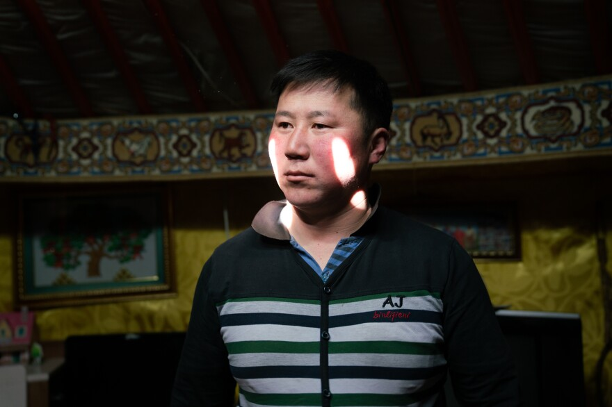 "Oyutan Gonchig, 35, is part of a herding family and grew up racing horses. In 2000, a <em>dzud</em> claimed his livestock. Oyutan and many others left the countryside and moved to Mongolia's capital, Ulaanbaatar, shortly thereafter. ""No one wanted to stay in the countryside, because it was just impossible to make a living,"" he says."