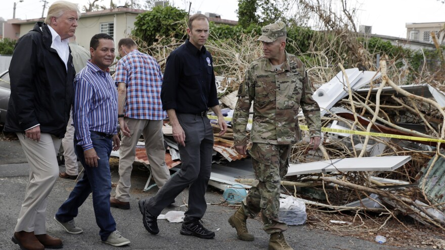 President Trump walks with FEMA administrator Brock Long (second from right) and Lt. Gen. Jeff Buchanan (right) as he tours an area affected by Hurricane Maria in Guaynabo, Puerto Rico, on Oct. 3.
