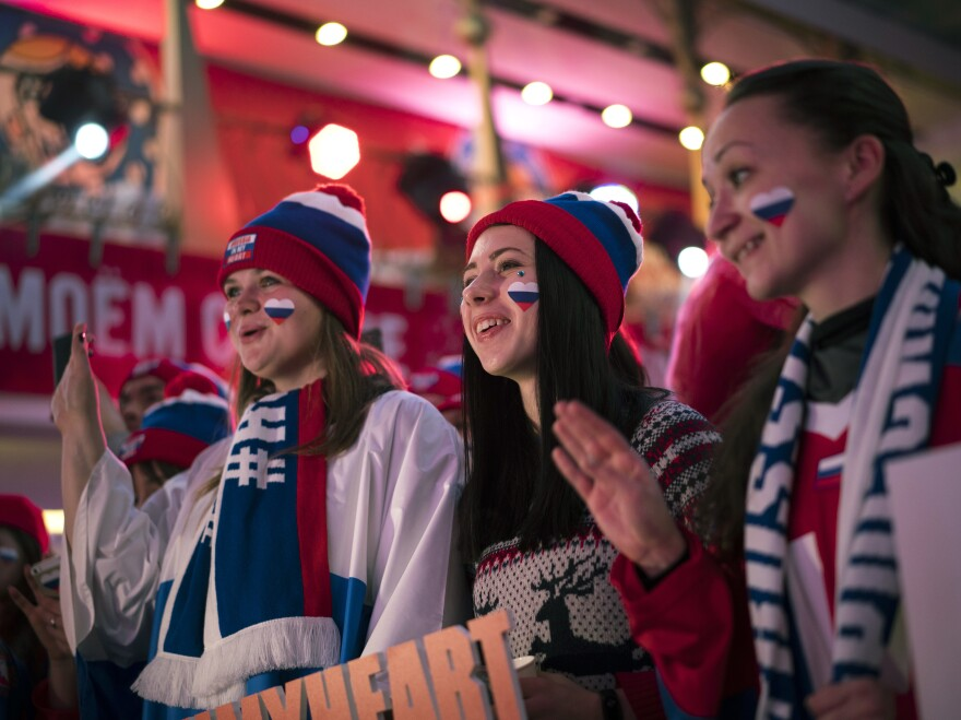 Fans of Russia cheer at the opening of the Sports House on Feb. 9.