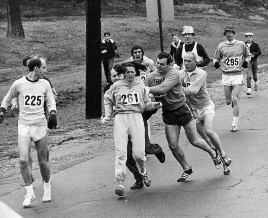 "In 1967, Kathrine Switzer was spotted early in the Boston Marathon by race director Jock Semple, who tried to rip the number off her shirt and remove her from the race. Switzer's friends intervened, allowing her to make her getaway to become the first woman to ""officially"" run the Boston Marathon."