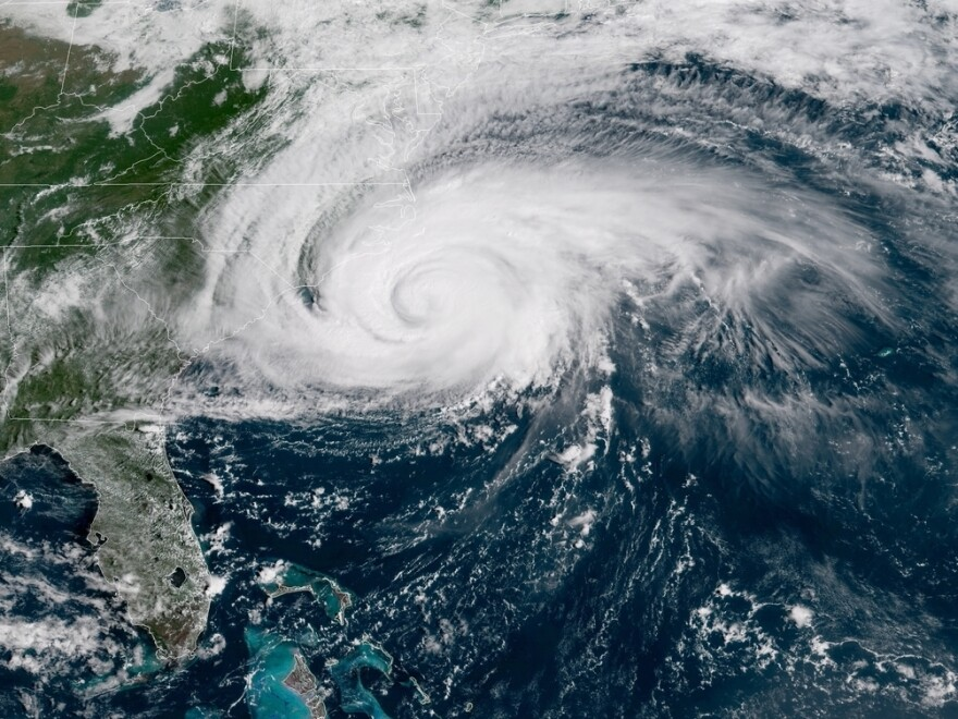 """Hurricane Florence will bring """"catastrophic flash flooding"""" to the Carolinas, the National Hurricane Center says. Sustained hurricane-force winds are hitting North Carolina."""