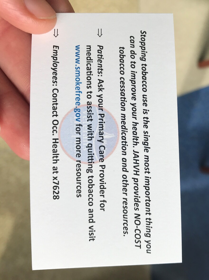 "One side of the ""Quit Cards"" VA staff are handing out to people they spot smoking on the campus."