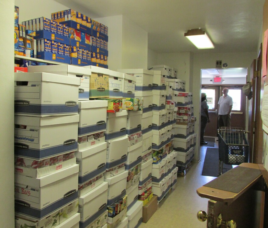 Food boxes are stacked this summer at the food pantry at St. Stephen's Episcopal Church in Ferguson.