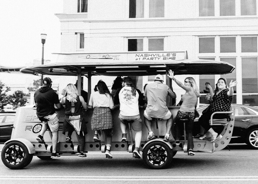 A pedal tavern is a multiseated bicycle you ride with a group, while drinking. Nashville visitors cannot get enough of them.