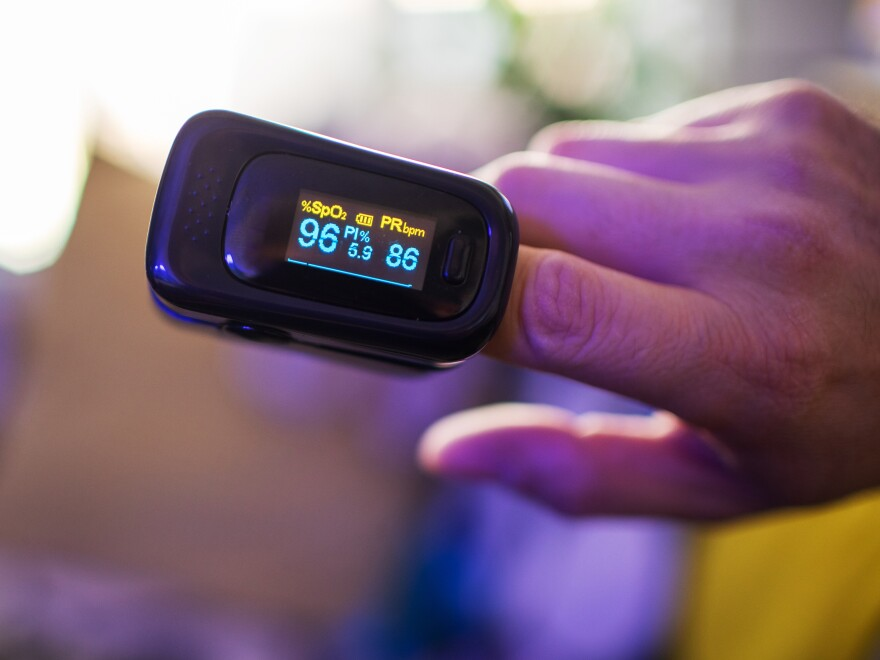 A pulse oximeter provides a quick read on the saturation of oxygen in your blood. Some doctors believe it is a helpful device to have at home during the coronavirus pandemic. Others aren't so sure.