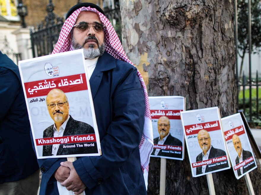 Jamal Khashoggi's fiancee and others will speak about his life and legacy on Friday, one month after he was killed in Saudi Arabia's consulate in Istanbul. Here, a protester holds a placard showing solidarity for Khashoggi during a demonstration outside the Saudi Arabian Embassy in London last week.