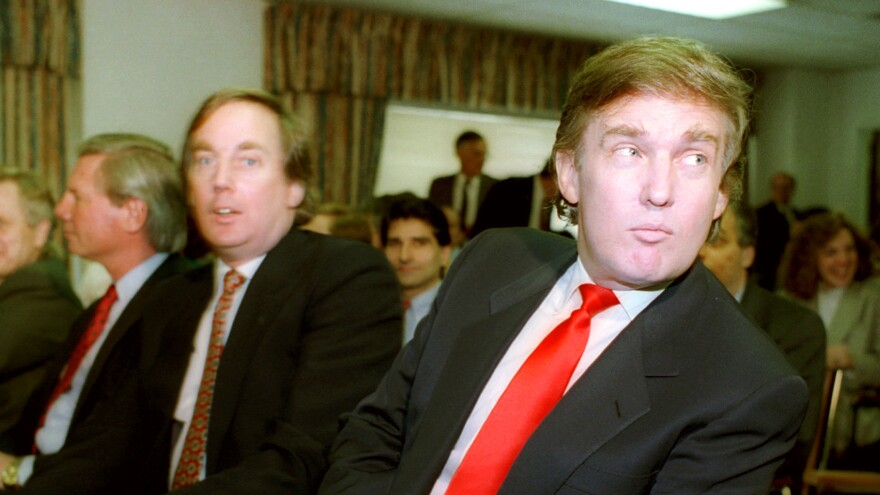 Donald Trump (right) waits with his brother Robert for the start of a Casino Control Commission meeting in Atlantic City, N.J., on March 29, 1990. Trump was seeking final approval for the Taj Mahal Casino and Hotel.