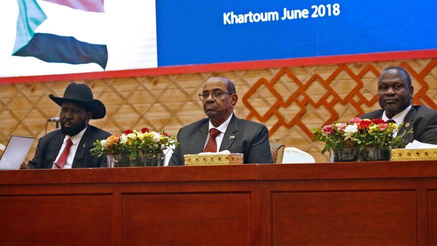 South Sudan President Salva Kiir, left, Sudanese President Omar al-Bashir, center, and South Sudanese rebel leader Riek Machar appear after talks in Khartoum aimed at ending South Sudan's civil war.