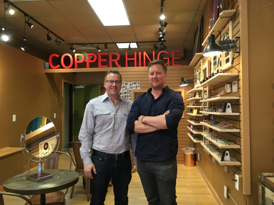 Tony and Jack Erker are fifth-generation opticians who are challenging online vendors with a brick-and-mortar experience where customers can watch frames being made in a mini factory. June 2018