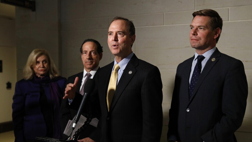 Rep. Adam Schiff (center) chairs the House Intelligence Committee, which would conduct any open hearings under the House impeachment inquiry, according to procedures specified in a resolution formalizing the process.