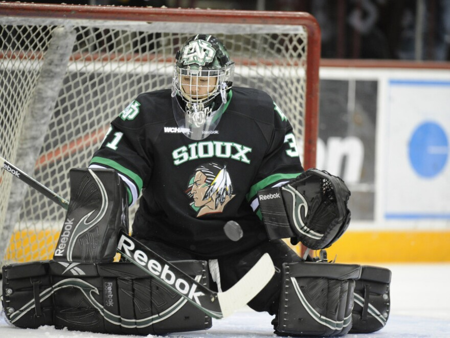 """The University of North Dakota's Brad Eidsness makes a save during a game against the Minnesota Golden Gophers. Since 2005, there have been a series of lawsuits and legislative actions over the nickname for the school's athletic teams, the """"Fighting Sioux."""""""