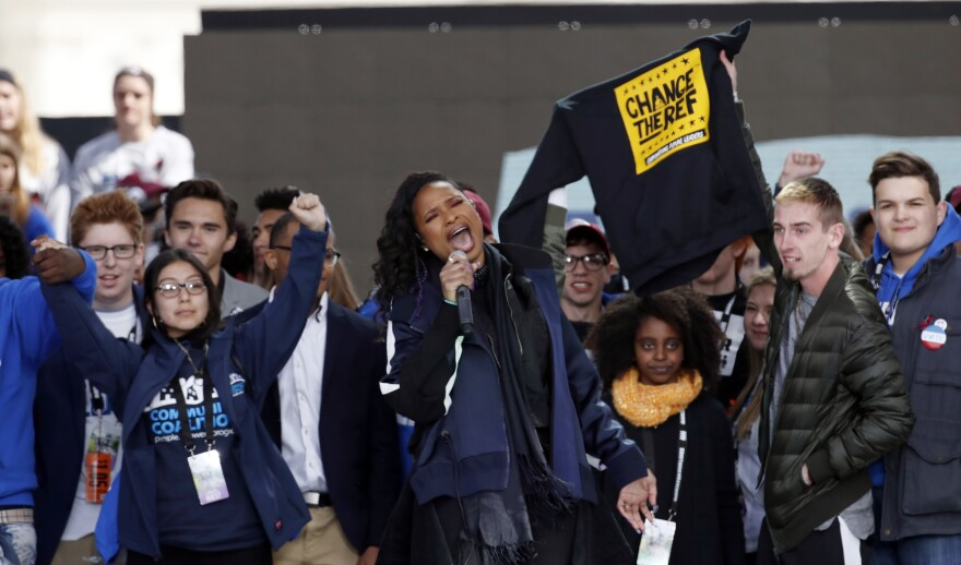 Jennifer Hudson (center) performs at the March for Our Lives.