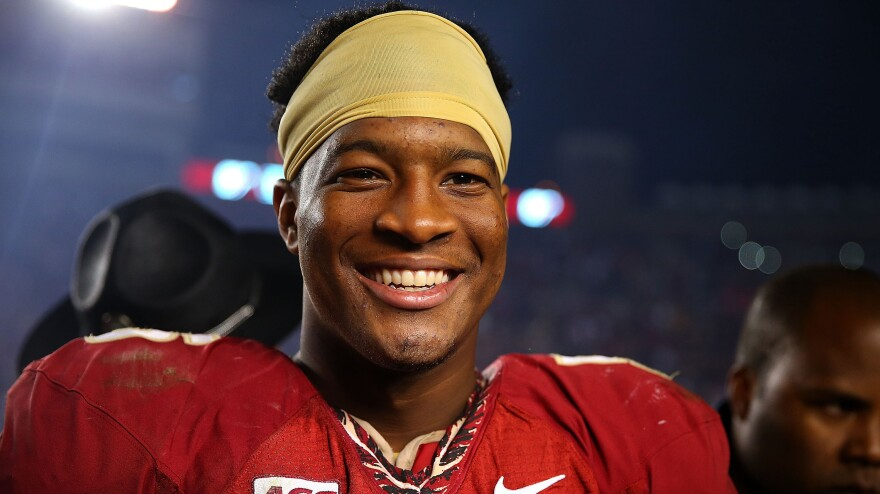 Florida State University quarterback Jameis Winston won the 2013 Heisman Trophy as college football's best player. He's shown here in a Nov. 2 game against Miami.