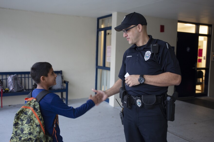 Officers shakes hands with schoolboy