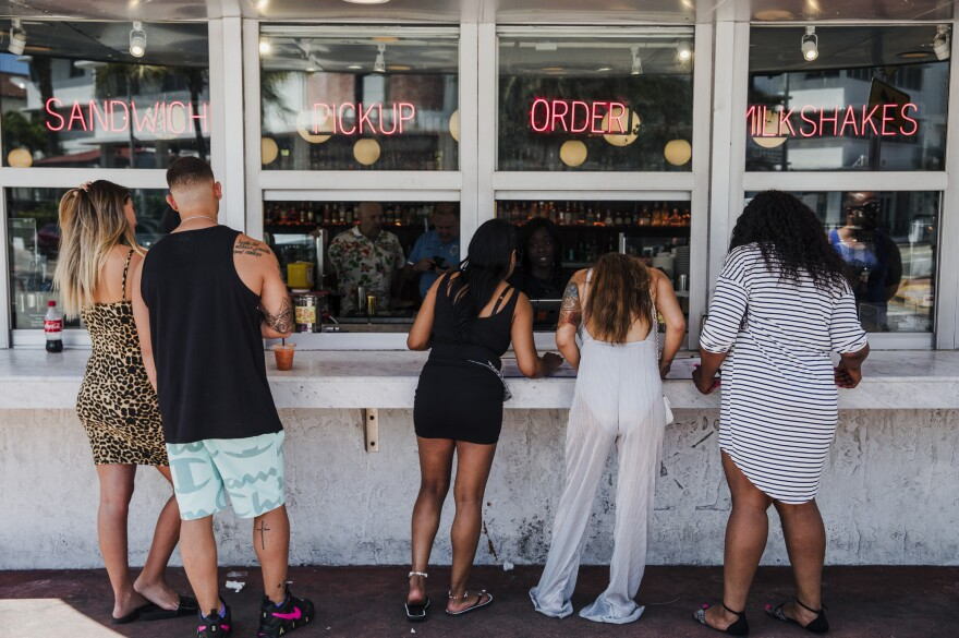 Customers at this take-out window in Miami on March 20 were not practicing social distancing.