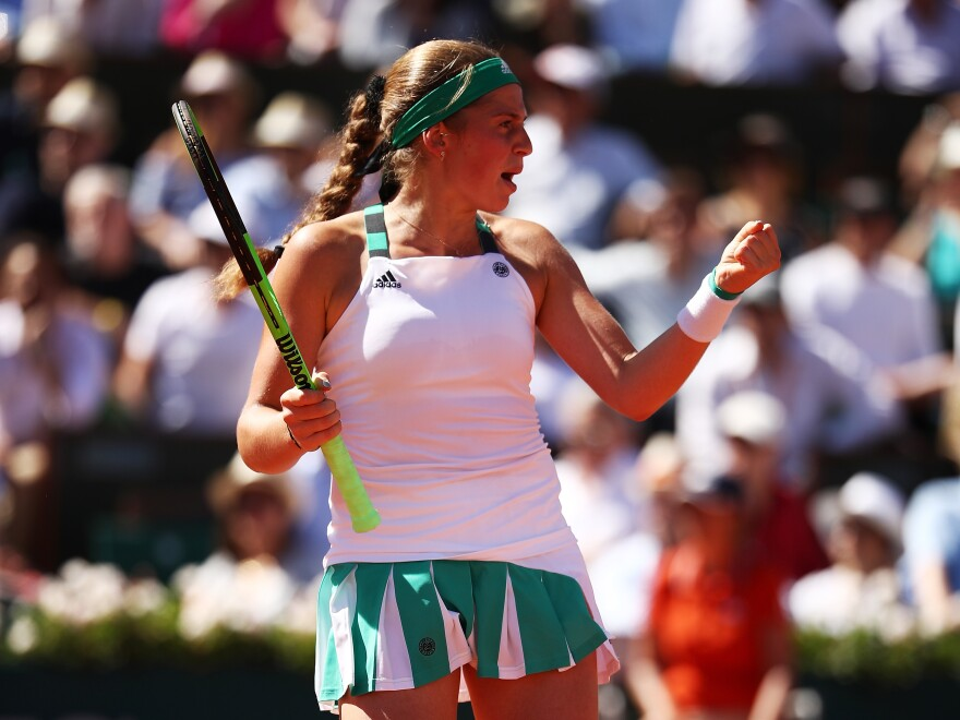 Jelena Ostapenko celebrates a point during the French Open final in Paris on Saturday. The unseeded Latvian upset Simona Halep with a ferocious performance full of both winners and unforced errors.