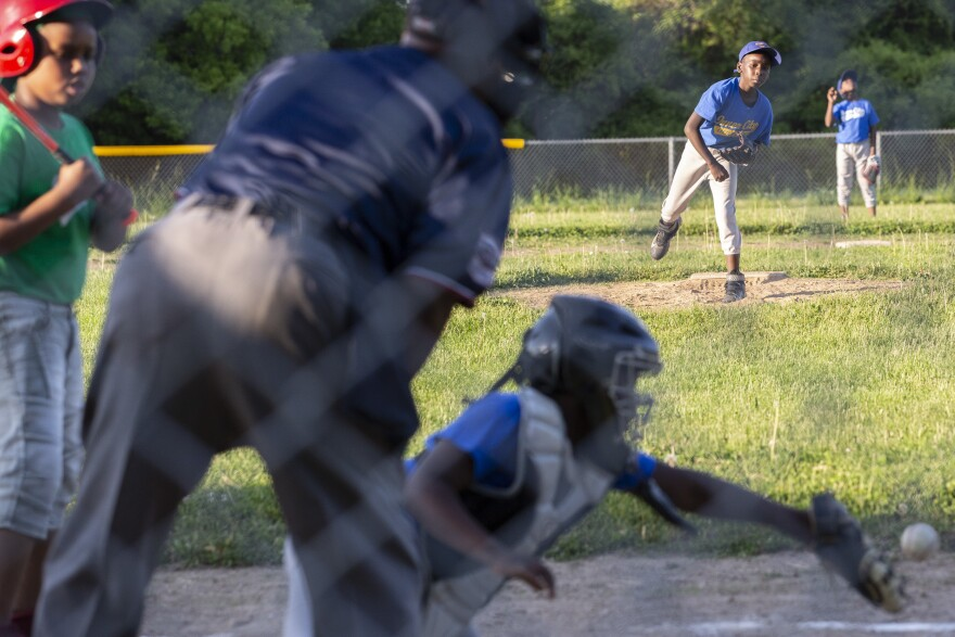 Tahjere Dowdell, 11, throws a few pitches to catcher Ga'verri Jones-Collins between innings.