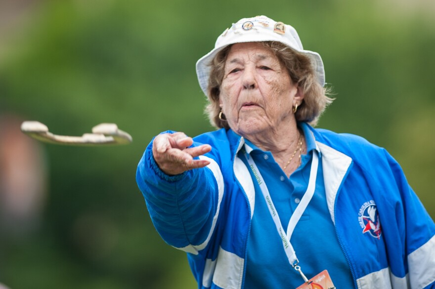 Hazel Trexler-Campbell throws spray-painted horseshoes during the Senior Games in Cleveland on July 23.