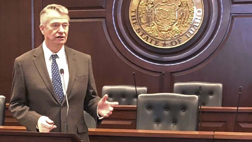 Idaho Gov. Brad Little speaks with reporters at the Statehouse in Boise last month. In a statement released Wednesday, Little told residents that some businesses — those at which safe social distancing can be practiced — may have an opportunity to reopen after April 30.