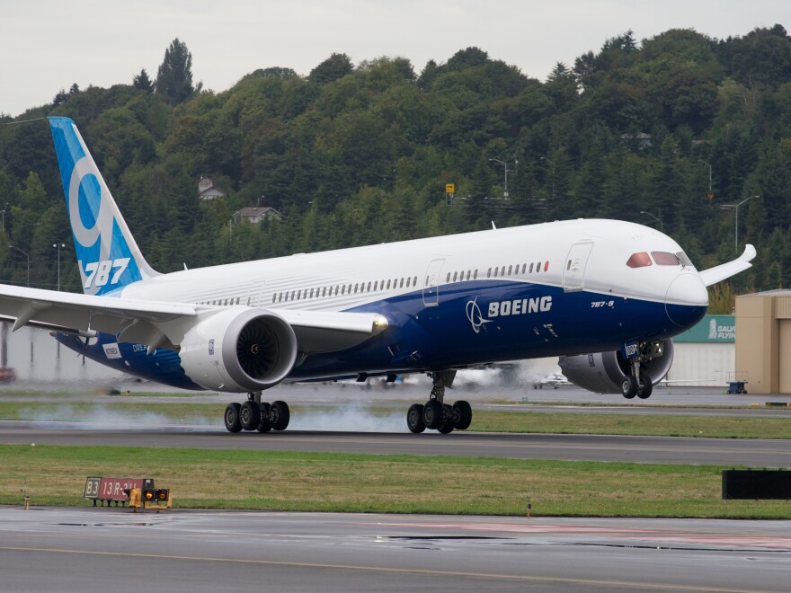 A Boeing 787-9 lands after its first flight on September 17, 2013 at Boeing Field in Seattle, Washington. The aircraft maker delivered 65 of the new jetliners last year.