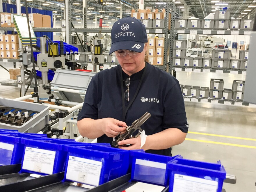 A worker assembles a handgun at the new Beretta plant in Gallatin, Tenn. The Italian gun maker has cited Tennessee's support for gun rights in moving its production from its plant in Maryland.