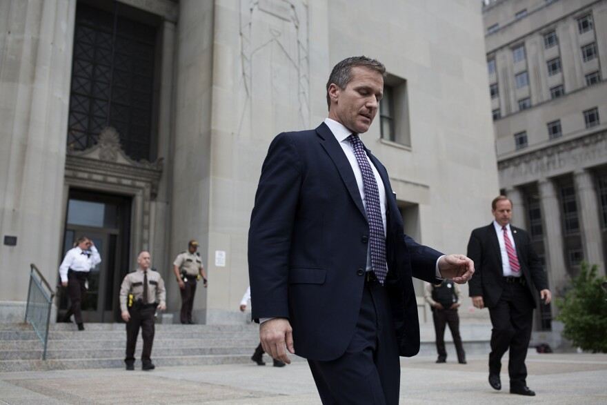 Missouri Gov. Eric Greitens walks out of the Civil Courts Building in downtown St. Louis after his felony invasion of privacy charge was dropped. May 14, 2018
