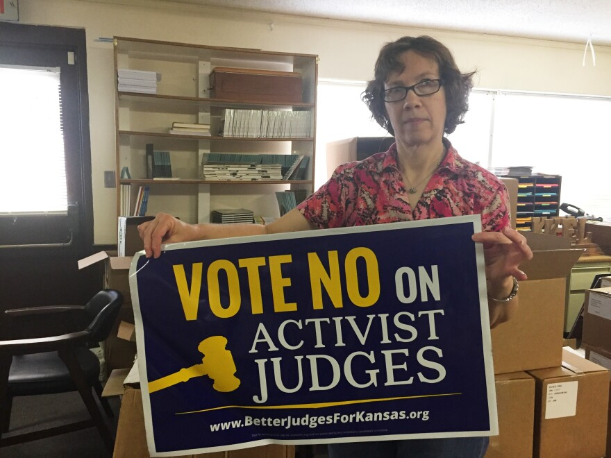 Susan Guthrie works for Kansans for Life, the state's most vocal anti-abortion organization and one of the groups campaigning against some of the Supreme Court justices up for re-election.