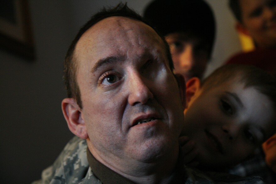 To document the veterans at Walter Reed hospital with PTSD, du Cille photographed Army Sgt. John Daniel Shannon, a sniper who was injured in Iraq, with his son, Drake Shannon (right).