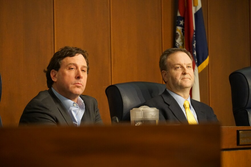 St. Louis County Executive Steve Stenger (left) and Sam Page (right) attend a county council meeting. A new resolution calls on the prosecuting attorney to look into if Stenger violated county charter.