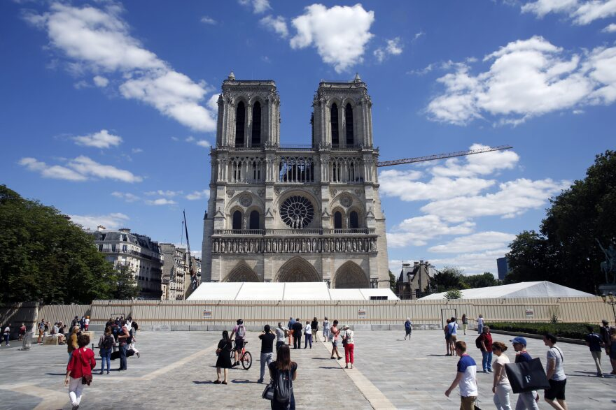 People walk on the forecourt of Notre Dame's Cathedral, in Paris, Sunday, May 31, 2020. Notre Dame Cathedral's forecourt is being opened up to the public for the first time since the devastating fire of April 15 last year. (Thibault Camus/AP)