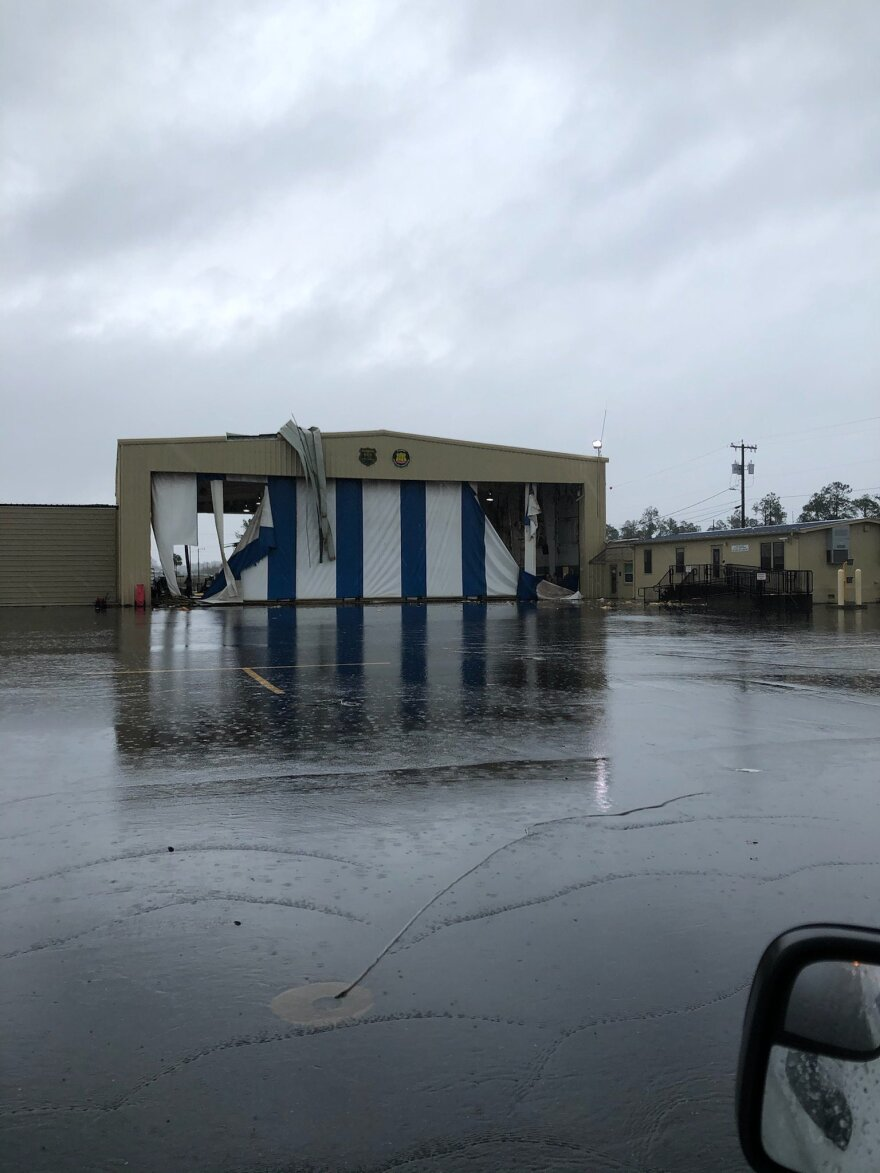 A damaged airplane hanger at the Tallahassee International Airport after a tornado strike