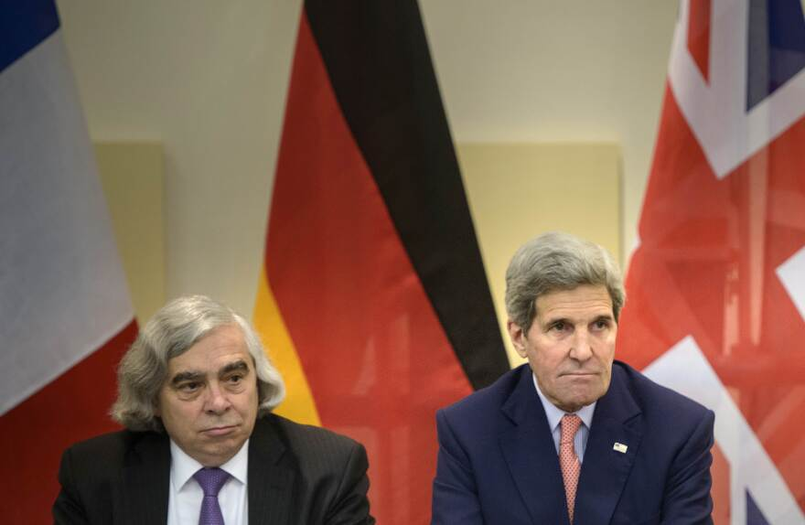 Secretary of Energy, Ernest Moniz, left, and Secretary of State, John Kerry wait for the start of a trilateral meeting at an hotel in Lausanne in March.