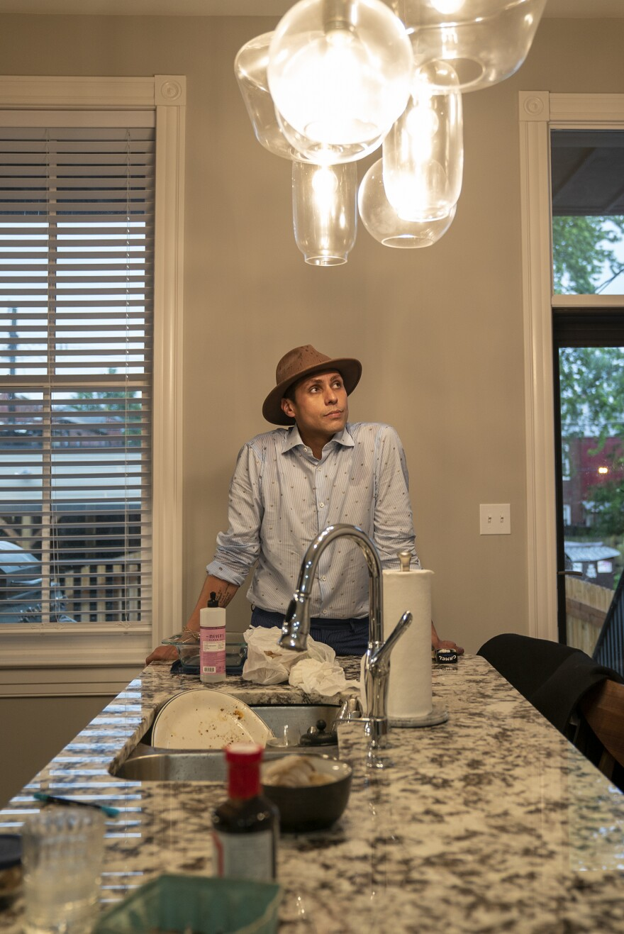 Omar Row stands in the kitchen of his new Benton Park home on May 28. 05 28 2020