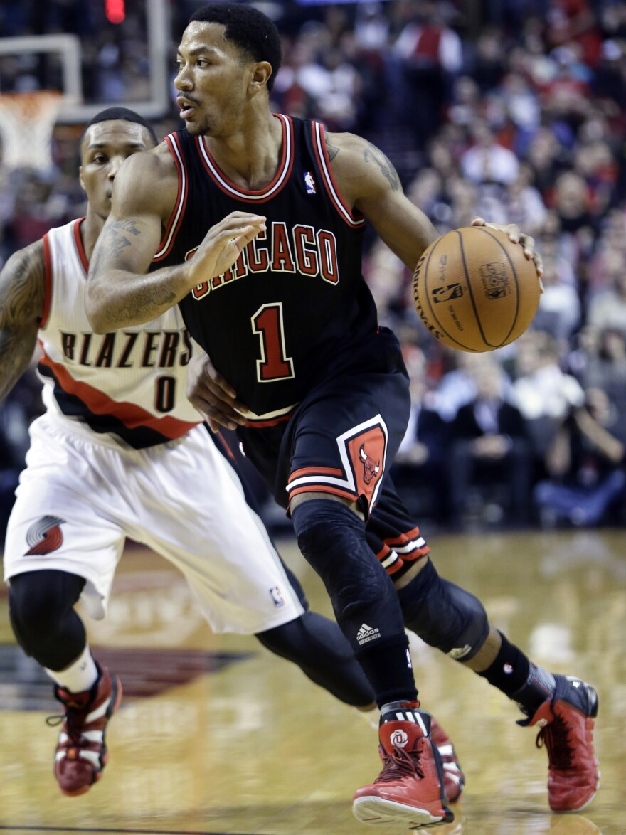 Chicago Bulls guard Derrick Rose, right, is out for the season after injuring his right knee Friday against the Portland Trail Blazers. Rose missed all of last season with an injury to his left knee.