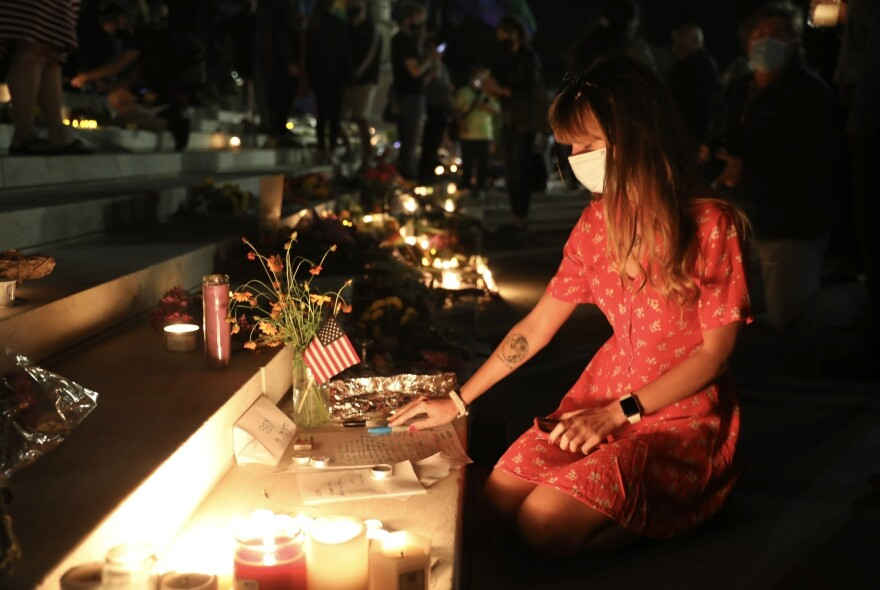 People lit candles and left flowers and notes on the steps of the court.