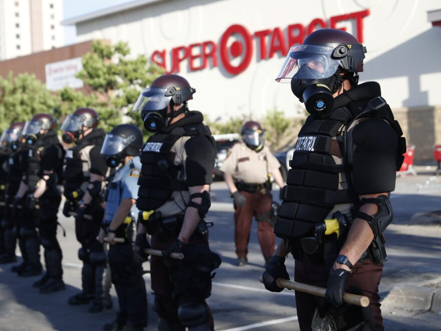 On Thursday, Minnesota state police formed a barricade in front of a Target store in the city of St. Paul.