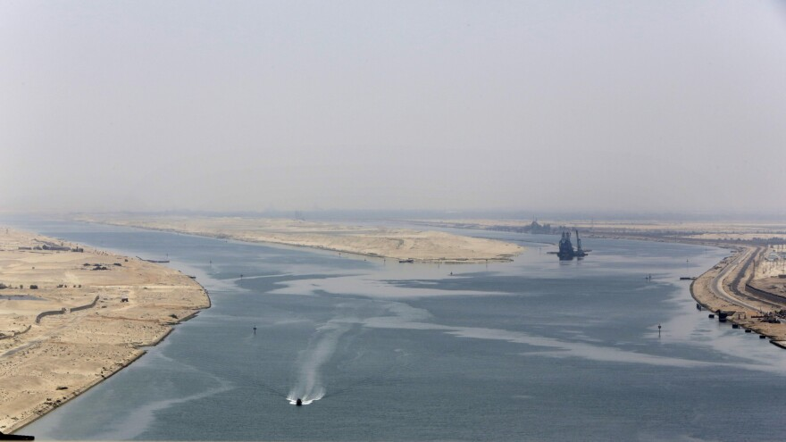 An army zodiac secures the entrance of the new section of the Suez Canal in Ismailia, Egypt, on Thursday.