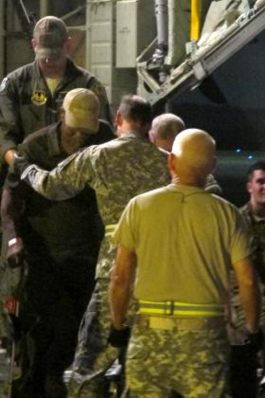 A patient is taken off a medical evacuation flight from St. Croix that arrived in Atlanta.