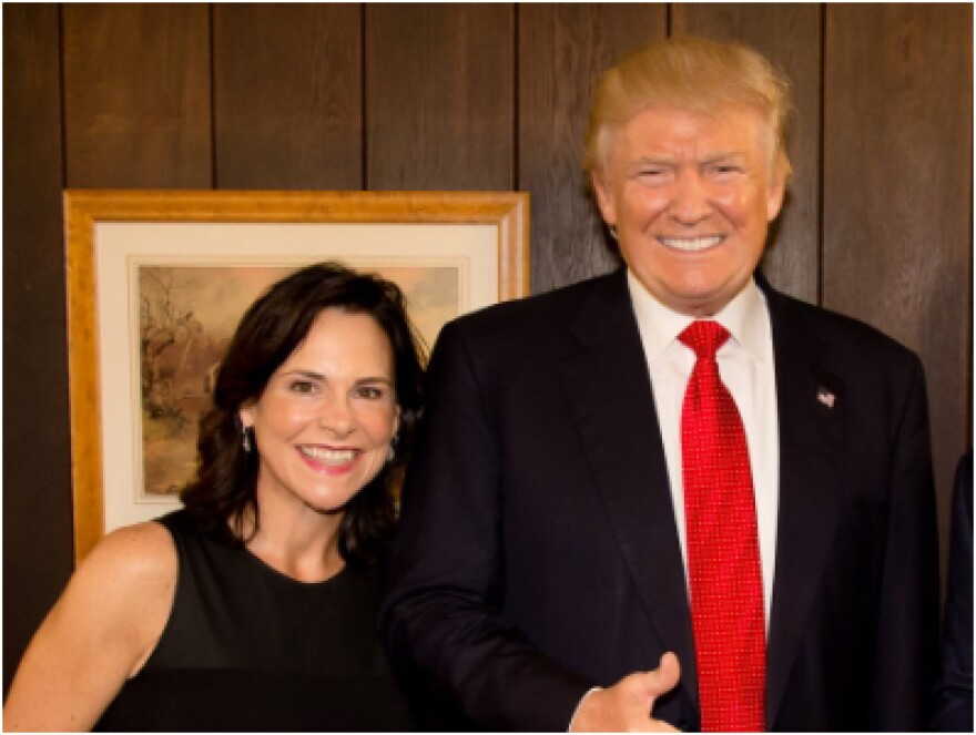 Jane Timken poses with Donald Trump