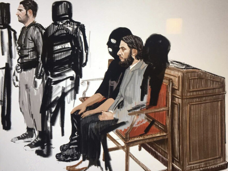 In this courtroom sketch, Salah Abdeslam (right) and Sofien Ayari (left) appear at the Brussels Justice Palace on Monday to face charges related to a police shootout following the deadly attacks on Paris.