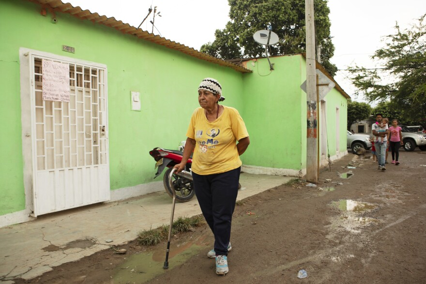 Ligia Blanco, 72, walks with a cane because of a heart operation. She comes to the kitchen to eat because of lack of affordable food in her home country of Venezuela.