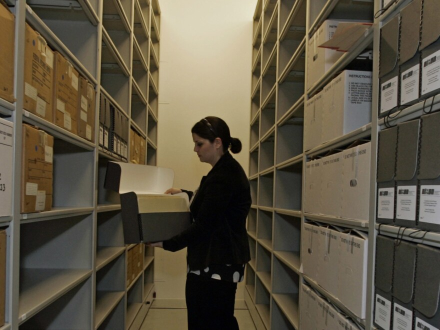 Nixon Presidential Library archivist Meghan Lee looks at boxes containing the Committee for the Re-Election of the President collection's Jeb Stuart Magruder papers. Congress passed the Presidential Records Act out of concern that Richard Nixon would destroy his presidential papers.