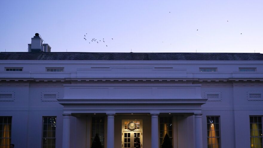 A Marine Corps soldier guards the West Wing of the White House on Wednesday.