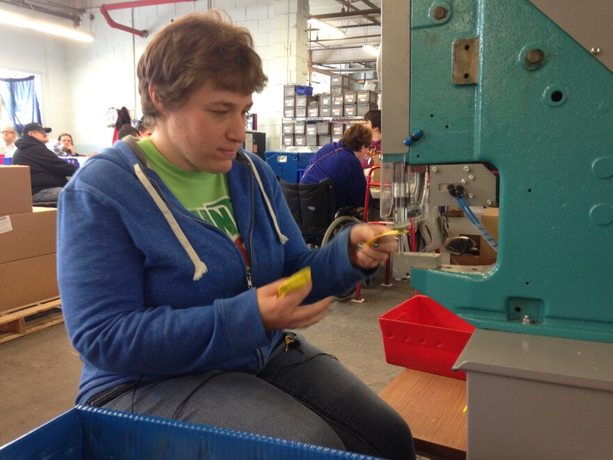 Beth Carpenter operates a grommet machine at Production Unlimited, a sheltered workshop in Watertown, N.Y.