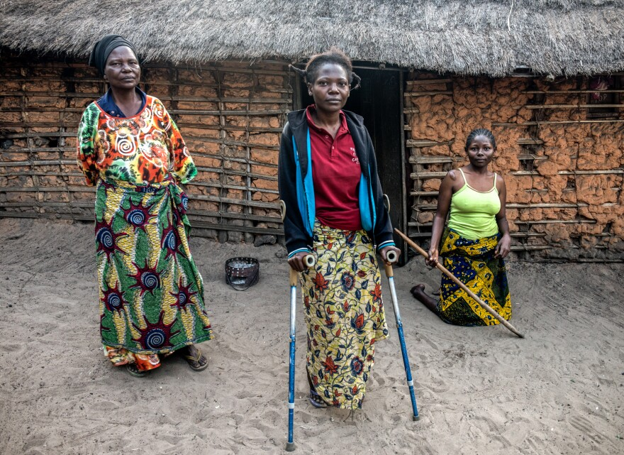 (From left) Cécile Mwandjombi and her two daughters, Nov Lutondo, 27, and Ruth Lutondo, 24, who have been disabled by konzo.