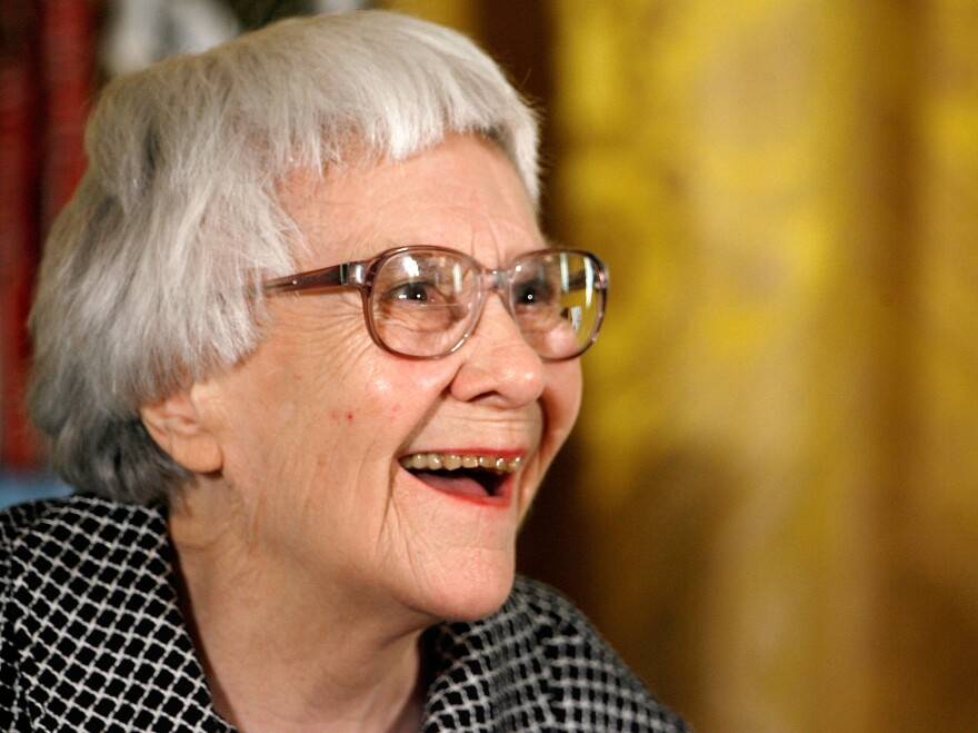 Harper Lee, seen here receiving the Presidential Medal of Freedom in 2007, actually wrote <em>Go Set a Watchman </em>first. But she set it aside when her editor suggested focusing on Scout's flashbacks instead — and she did, in what became <em>To Kill a Mockingbird.</em>