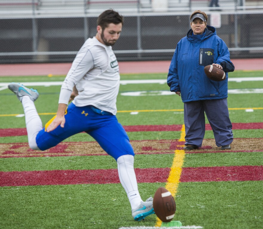 Sister Lisa runs through drills with the Saints' kicker Donovan Blatz prior to their game against Westminster at Public Schools Stadium in Duluth, Minn. The College of St. Scholastica would go on to defeat Westminster 48-12 and clinch the Upper Midwest Athletic Conference championship.