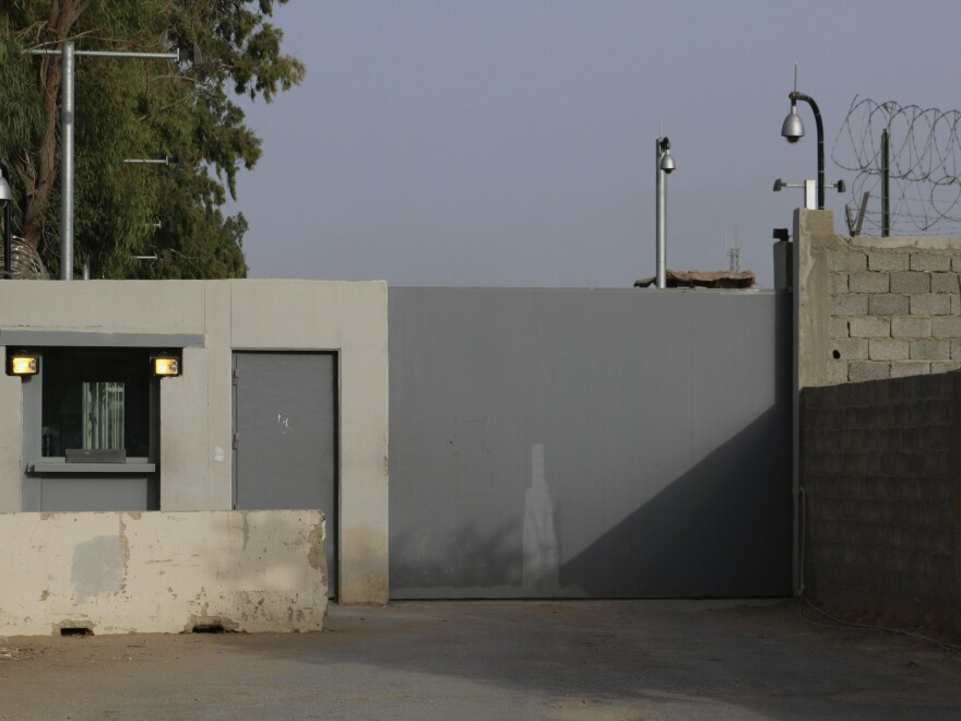 The entrance of the compounds of the U.S. embassy is pictured in Tripoli on Saturday. Fighting continues to rage after the U.S. evacuated the diplomatic facility.