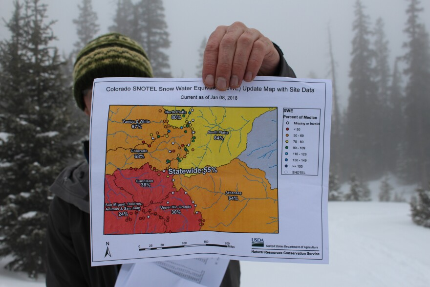Hydrologist Karl Wetlaufer with the Natural Resources Conservation Service holds a map showing Colorado's low snowpack on January 9, 2018.