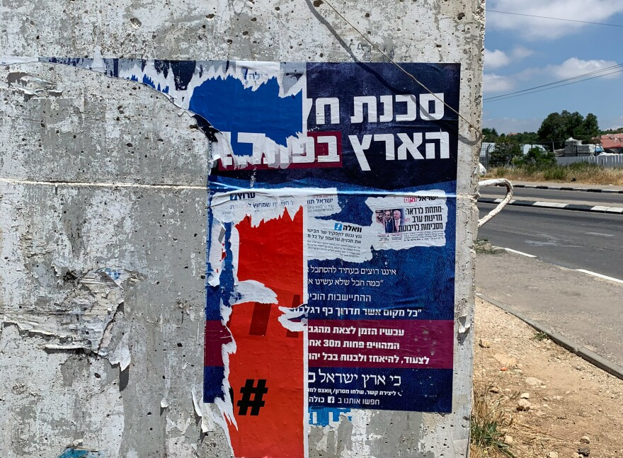 """The danger of dividing the land is nigh,"" reads a Hebrew poster plastered near a West Bank bus stop. Some Jewish settlers, who have long dreamed of turning Israel's military occupation into permanent sovereignty over the lands of the Bible, are mounting an unexpected campaign against Netanyahu's annexation plan. The plan would leave areas for Palestinians to establish some autonomy."